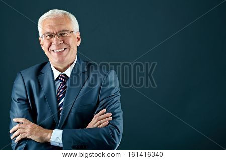 Portrait of a smiling senior businessman looking at camera