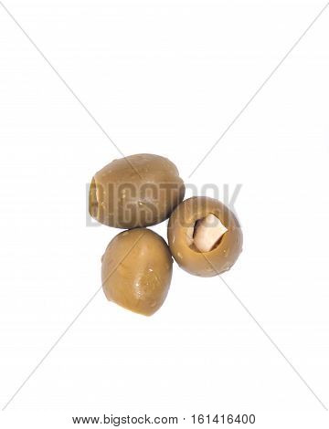 Green colossal olives hand stuffed with garlic gloves isolated on white background