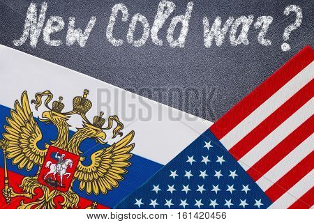 New cold War text written on chalkboard, Flags of USA and Russia