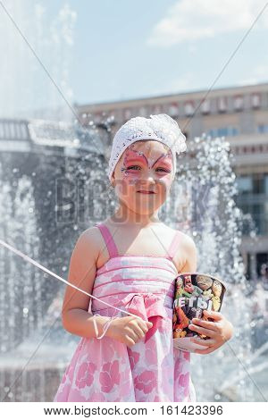 NOVOKUZNETSK KEMEROVO REGION RUSSIA - JUNE 01 2012 :: Children's protection day. Soup bubbles day selebration. Cute little girl with face art.