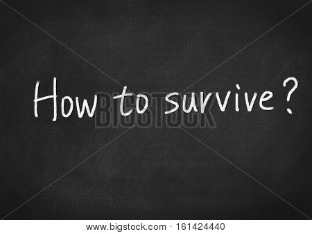 how to survive concept text on blackboard background