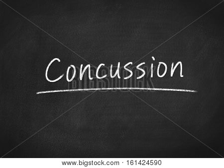 concussion concept text word on blackboard background