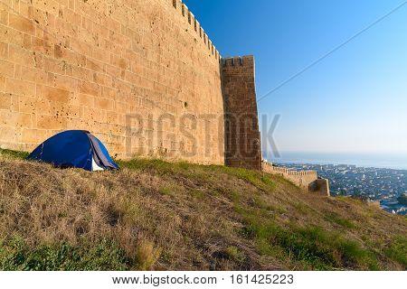 Tourist Tent Near Wall Of Naryn-kala Fortress. Derbent