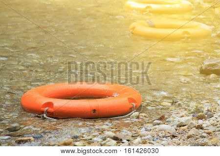 life preserver float in the river. Artificial light was added on the top right corner for 'HOPE and SAVE concept'.