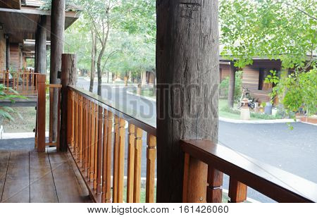 Teak wood Handrail in the porch of a Resort