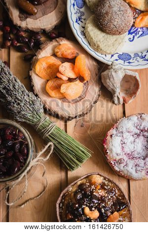 the composition of the traditional winter ingredients - dried fruits, pastries, rosehip seed tea, bundle of lavender