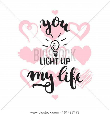 You light up my life - hand drawn lettering phrase isolated on the white background with hearts. Fun brush ink inscription for Valentines Day photo overlays, greeting card, poster design