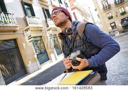 Photo reporter writing notes on photo tour