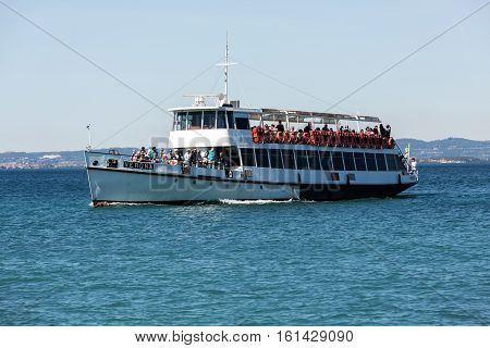 LAZISE, ITALY - MAY 4, 2016: Ferry boat on Lake Garda. Garda Lake is one of the most frequented tourist regions of Italy.