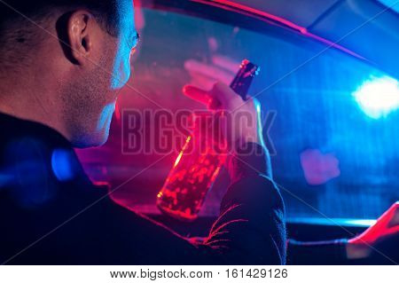 Drunk Driver On The Background Of Police Car Light