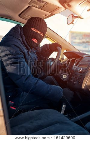 Car Thief In Black Robbery Mask Stealing Auto.