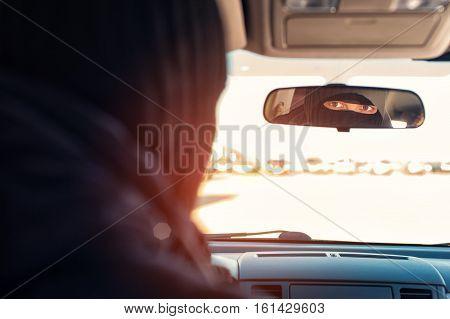 Male Robber In Black Mask Sitting In Stolen Car