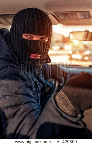 Portrait Of Male Thief Driving A Stolen Car