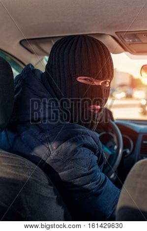 Man In Black Robbery Mask Driving A Stolen Car
