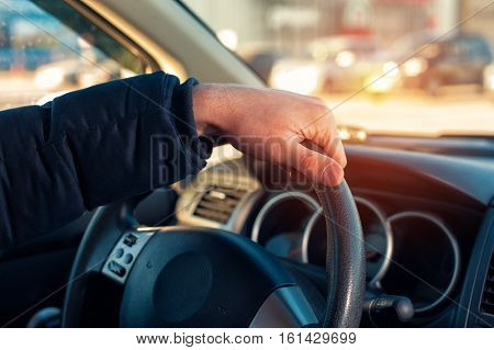 Male Hand Holding Steering Wheel While Driving A Car