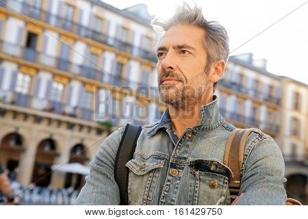 Mature man visiting european city