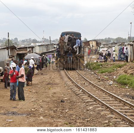 KIBERA, KENYA-DECEMBER 6, 2010: A train comes through Kibera, Africaâ??s largest urban slum