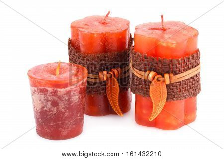 Three candles isolated on white background, close up picture.