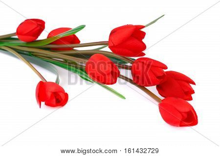 Red fabric tulips isolated on white background.