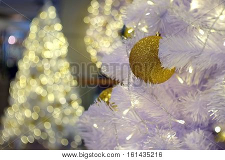 Christmas gold ball with white tree on bokeh shinny christmas Tree background.