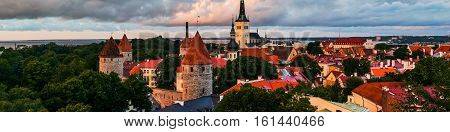 Tallinn Estonia. Aerial view of old town of the Estonia capital touristic city Tallinn. Red rooftops with colorful cloudy sky. Popular landmark in Baltic region.
