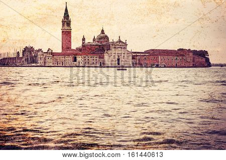 Famous church San Giorgio Maggiore in Venice (Italy). Photo is edited as an old dirty and vintage with dark edges. Free place for your text is in the lower part of the photo.