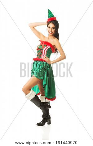 Front view of beautiful woman wearing elf clothes, touching her head