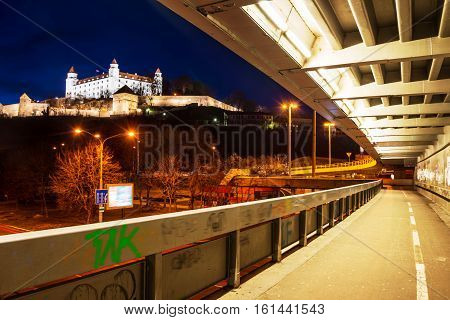 Bratislava Slovakia. Night view of the castle and illuminated historical buildings with bridge in the capital of Slovakia Bratislava