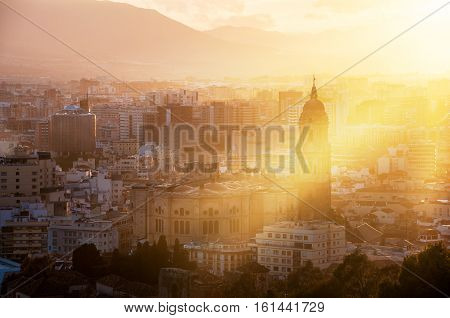 Malaga Spain. Aerial view of Malaga Andalusia at sunset. Sunlight going through the cathedral