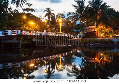Summer resort at Ko Samui Thailand. Little bungalow hidden in the trees with water at sunset