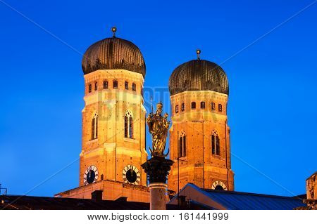 Munich Germany. Illuminated Mary's Column with the Church of Our Lady in Munich the capital of Bavaria in Germany at night