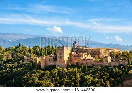 Granada Spain. Aerial view of Alhambra Palace in Granada Spain with Sierra Nevada mountains at the background during the sunny day