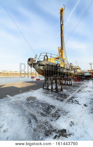 MOSCOW, RUSSIA - NOVEMBER 11, 2016: State Unitary Enterprise Mosvodostok performs recovery vessels on coastal winter parking. The boat is mounted on metal supports.