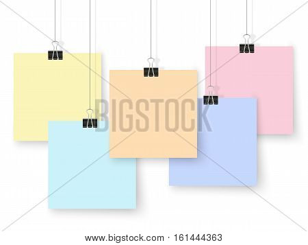 Posters on binder clips. Colorful notepad paper templates. Realistic vector illustration. Empty mockup frames for your drawings quotes or lettering.