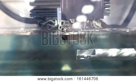 industrial machine and factory robot concept - Close up precision factory robot machine process under water in car parts factory and copy space