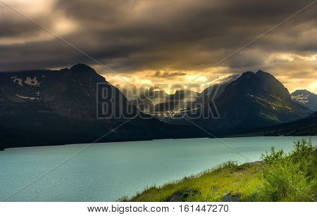 Sunset over lake in Glacier National Park Montana