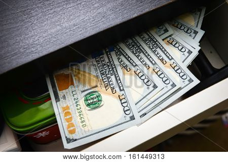 One Hundred Bills In Desk Drawer