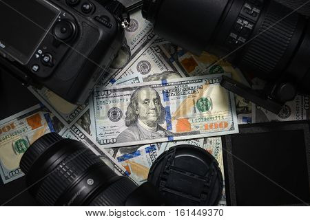 Background American One Hundred Dollar Bills And Dslr Camera Devices