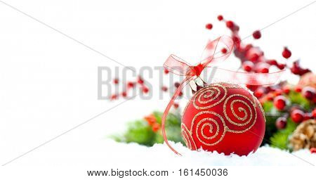 Red Christmas and New Year Decoration isolated on white background. Border art design with holiday bauble. Beautiful Christmas tree closeup decorated with ball, holly berry. Space for your text