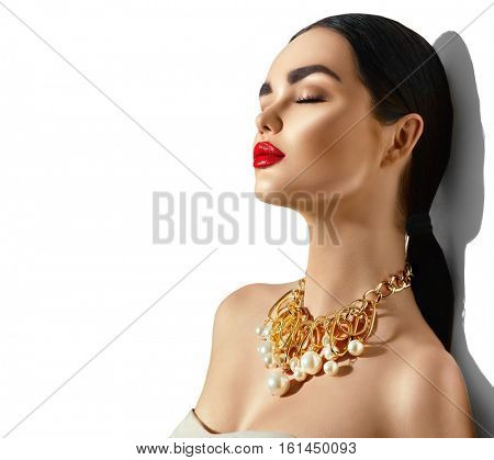 Beauty fashion model brunette girl portrait. Sexy young woman with perfect makeup and trendy golden accessories. High fashion glamour female