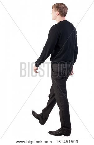 back view of walking  business man.  blond smiling man in a sweater and pants goes to the right. Isolated over white background. Rear view people collection.  backside view of person.