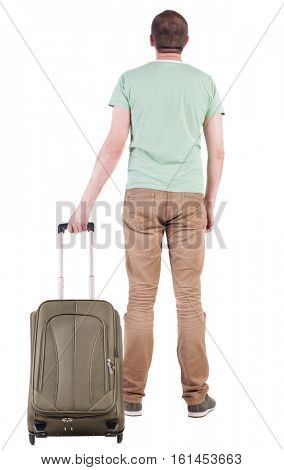 Back view of man with  green suitcase looking up. Rear view people collection.  backside view of person.  Isolated over white background. man in a T-shirt holding a duffel bag on wheels