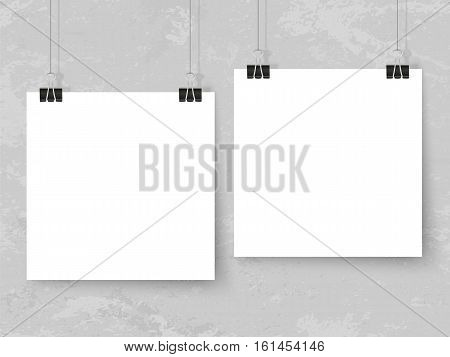 Posters on binder clips on grunge grey wall. Realistic vector illustration. Modern trendy interior. Empty mockup for your illustrations drawings logos posters or quotes.