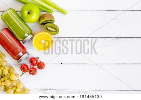 freshly squeezed juices for detox on wooden background top view.