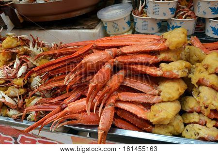Cooked legs crab are on the shopping tray for sale in Wangfujiang street in China