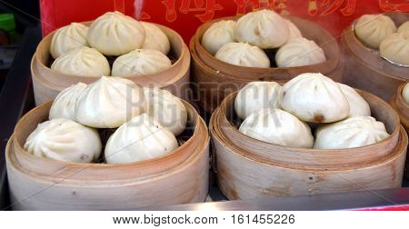 Wangfujing Snack Street. Street food booth selling specialty Chinese Steamed Dumplings in Beijing Located in Beijing China.