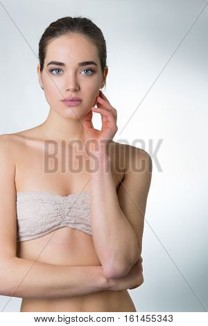 Beautiful Young Woman Touching Her Face With Palms. Beauty Female Portrait. Anti Aging, Skincare, Beauty Treatment. Health Care Concept.