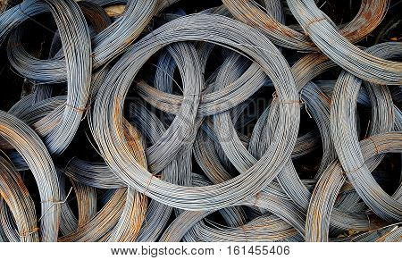 Coils of old galvanized wires with traces of rust