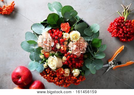 Beautiful flower composition with berries in box, top view