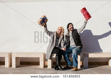 Cheerful Couple Exchanging Gifts